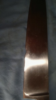 before image of knife with large chip